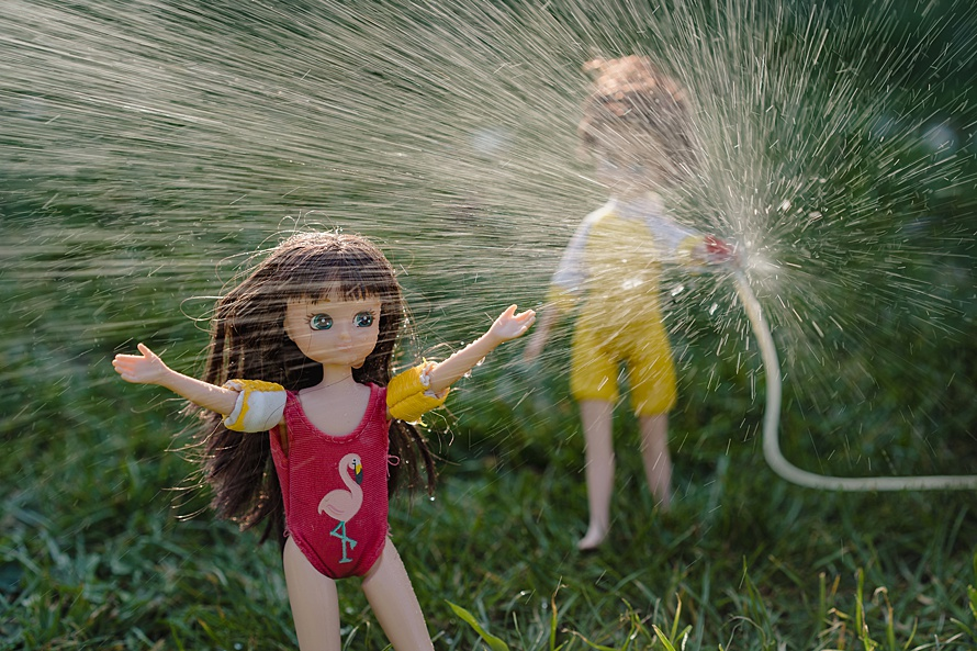 Two dolls having a water fight for Emma Collins Lottie Doll project